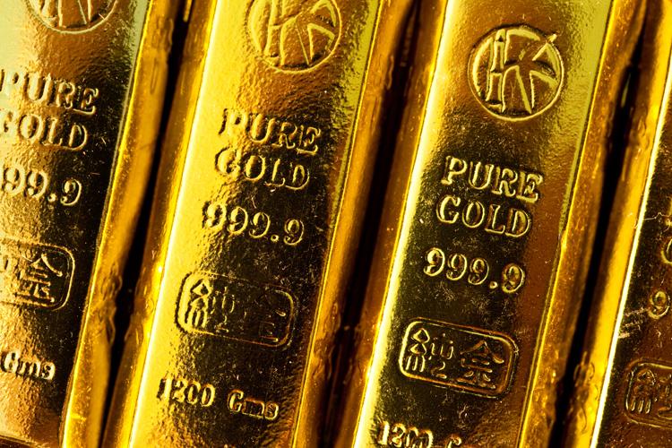 Gold und Goldbarren betrachten viele als sichere Geldanlage